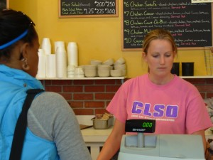 Working as a cashier is just one of many college campus jobs.